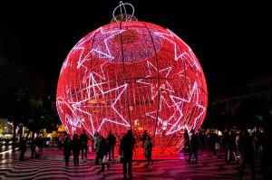 Lisbon, Portugal: People stand next to a giant Christmas ball